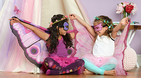 Girls playing dressed up as butterflies
